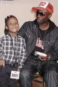 THE KID JAMS: Six-year-old JRP-Connecticut student Kai Rumcheran finds a fan in MTV's Yo-Mamma star Sam Sarpong, who was so impressed with Kai that he invited him to a live taping session on the day they met.
