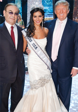 Rima Fakih's whole world is about to change as she pauses to pose with Judge Phil Ruffin (L), and Donald Trump (R) on stage after the 59th annual MISS USA competition before embarking on her world-wide promotional tour.
