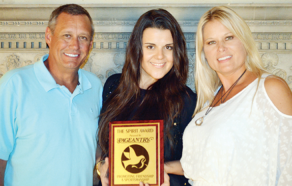 Pageantry Beauty Director Yulia Konstantinova-Riebman accepted the Pageantry Spirit Award from CEO Carl Dunn and Fashion Director Snejanna Dunn.