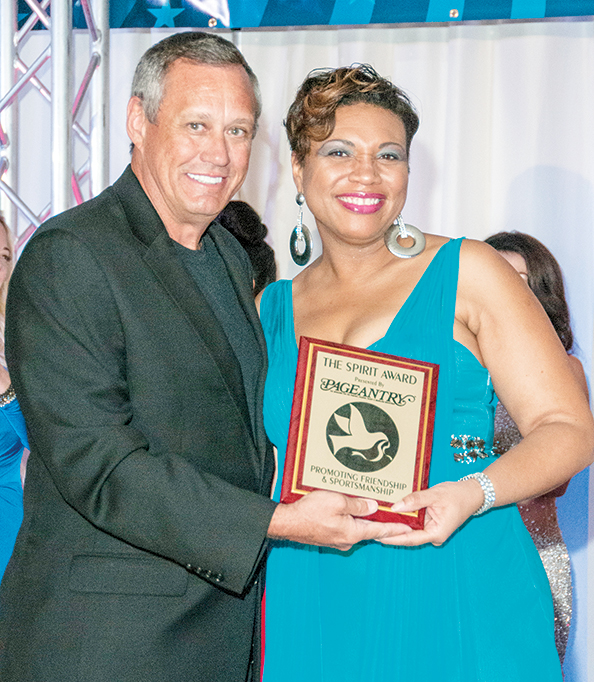 Dr. Veronica Walters is presented the Pageantry Spirit Award by Pageantry CEO Carl Dunn