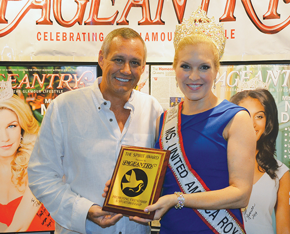 Pageantry CEO Carl Dunn congratulates Ms. United America Royal Carolyn Ladd